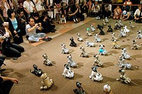 AIBO robot dog convention. AIBO Artificial Intelligence Robot is a robot programmed with several dog_like behaviours, including barking, falling over ...