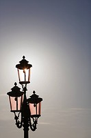 Street lantern with pink glass, St. Mark's square, Venice, Italy