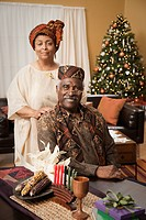 African couple celebrating Kwanzaa and Christmas