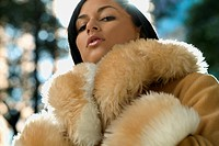 Sexy Hispanic woman wearing fur coat