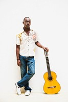 African man leaning on guitar