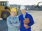 Construction workers standing on construction site (thumbnail)