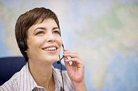 Businesswoman talking on headset in office