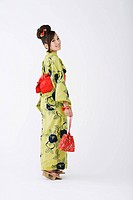 Woman in Yukata Holding Stylish Pouch Bag