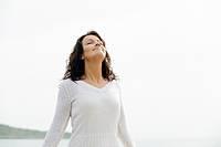 woman by the sea breathing fresh air