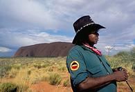 Aboriginal ranger and Ayers Rock in background, Uluru-Kata Tjuta National Park, Northern Territory, Australia