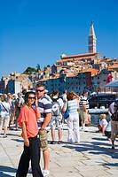 Tourists on the pier of the southern harbour of Rovinj, Istria, Croatia