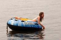 Teenager floating on a raft