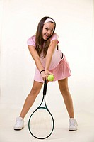 Happy tennis player in pink