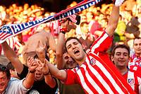 Atletico de Madrid supporters during a football match