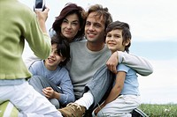 Child taking picture of family