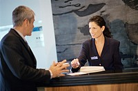 Receptionist talking with businessman