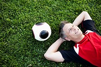 Soccer Player Relaxing On Grass