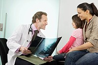 A male doctor showing patients an x_ray