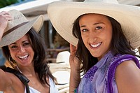 Hispanic women wearing hats