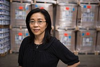 Chinese woman in warehouse