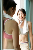 Two young women share a laughter moment after their exercise (thumbnail)