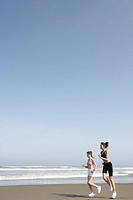 Two women jogging on the seashore (thumbnail)