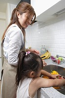 A mother and daughter in a kitchen
