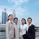 Low angle view of a businessman standing with three businesswomen (thumbnail)