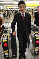Businessman at a railroad station