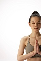 Close-up of a young woman meditating (thumbnail)