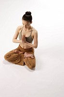 High angle view of a young woman in lotus position