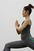 View of a young woman performing yoga