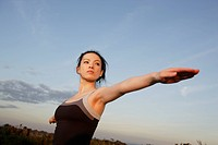 Low angle view of a young woman exercising (thumbnail)