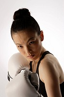 Portrait of a young woman with boxing gloves (thumbnail)