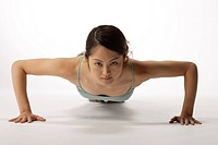 View of a young woman exercising pushup