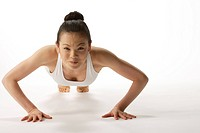 View of young woman exercising pushup
