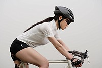 Close_up of a young woman bicycling