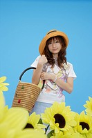 Portrait of a teenage girl holding a basket