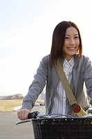 Close_up of young woman on a bicycle
