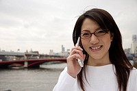 Close_up of a young woman using mobile phone