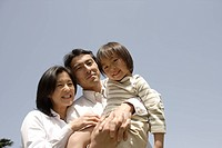 Portrait of parents smiling with daughter (thumbnail)