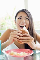 A young woman holding burger