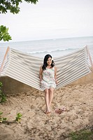 A woman sitting on hammock