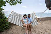 A couple sitting on hammock (thumbnail)