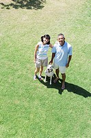 Elevated view of a couple standing with dog
