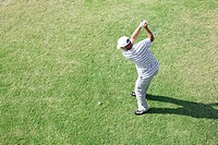 Elevated view of a man hitting golf ball