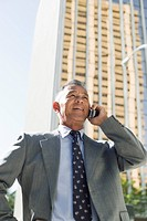 View of a businessman using mobile phone