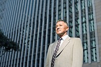 Low angle view of a businessman looking away