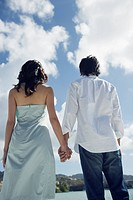 Rear view of a young couple holding hands