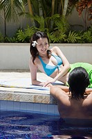 Man in pool and women looking at him (thumbnail)