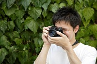 Portrait of a young man photographing