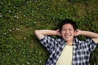 Portrait of a young man lying on ground