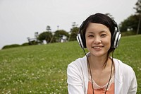 Portrait of a young woman listening to music (thumbnail)