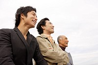 Young man with father and grandfather, smiling (thumbnail)